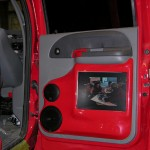 Inside door panel with television, red and gray
