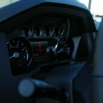 Black six-door Ford F650 interior- dash on passenger's side