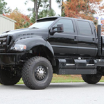 4x4 Ford F650- exterior, black side view, black gas tanks